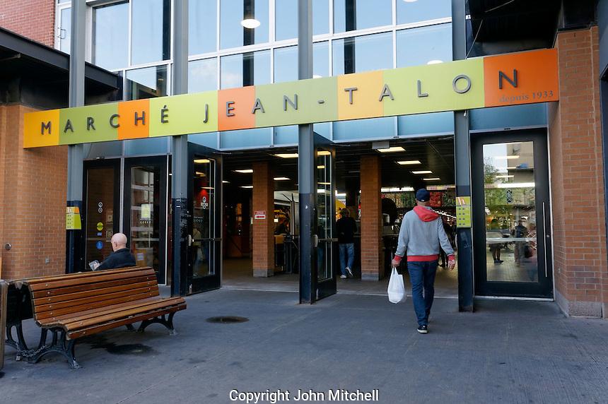 Man entering the Jean Talon Market, Montreal, Quebec, Canada