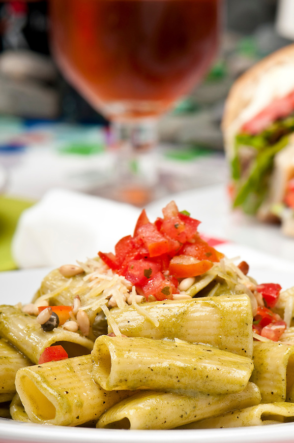 Plate of pasta salad and background in restaurant.