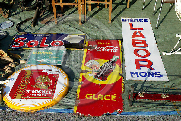WATERLOO - BELGIUM - 10 SEPTEMBER 2006 -- Antique market at the Carrefour supermarket parking sunday morning. Old enamel sign for Solo Magarine, Coca Cola, St. Michel Legeres cigarettes and Labor beer from Mons in Belgium. PHOTO: ERIK LUNTANG / EUP-IMAGES