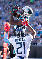 CHARLOTTE, NC - NOVEMBER 3: Curtis Samuel #10 of the Carolina Panthers catches a touchdown pass in front of Malcolm Butler #21 of the Tennessee Titans during a game between Tennessee Titans and Carolina Panthers at Bank of America Stadium on November 3, 2019 in Charlotte, North Carolina.