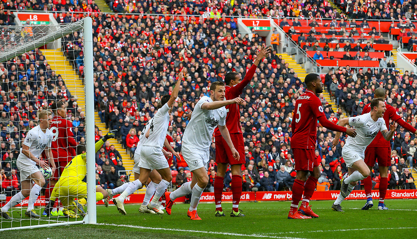 Burnley players celebrate after Ashley Westwood (not pictured) scored direct from a freekick<br /> <br /> Photographer Alex Dodd/CameraSport<br /> <br /> The Premier League - Liverpool v Burnley - Sunday 10th March 2019 - Anfield - Liverpool<br /> <br /> World Copyright © 2019 CameraSport. All rights reserved. 43 Linden Ave. Countesthorpe. Leicester. England. LE8 5PG - Tel: +44 (0) 116 277 4147 - admin@camerasport.com - www.camerasport.com