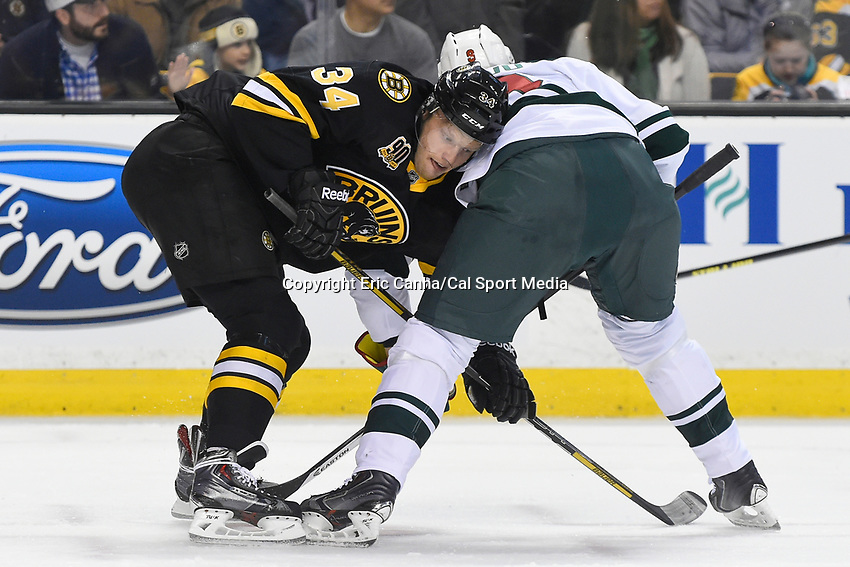 March 17, 2014 - Boston, Massachusetts , U.S. - Boston Bruins center Carl Soderberg (34) and Minnesota Wild center Mikko Koivu (9) battle at a face off during the NHL game between the Minnesota Wild and the Boston Bruins held at TD Garden in Boston Massachusetts.  Eric Canha/CSM