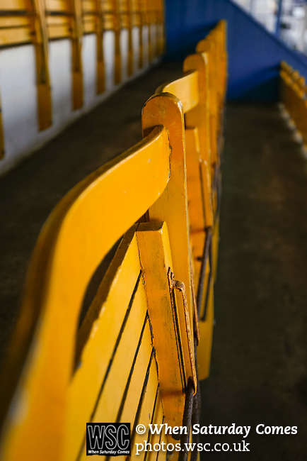 Yellow seats in the Jamie Vardy Stand at Look Local Stadium. The seats were originally used at Hillsborough. Stocksbridge Park Steels v Pickering Town, Evo-Stik East Division, 17th November 2018. Stocksbridge Park Steels were born from the works team of the local British Steel plant that dominates the town north of Sheffield.<br />