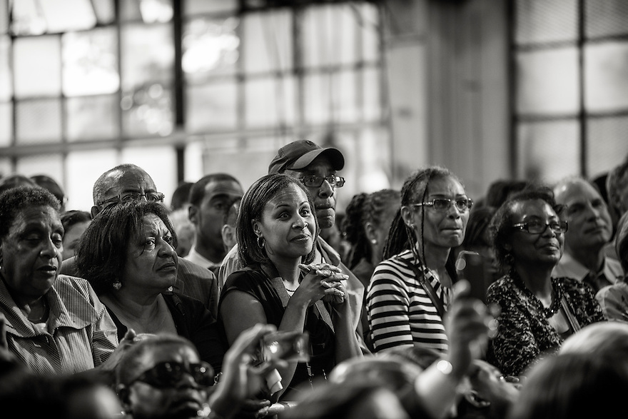 The audience listens as U.S. President Barack Obama speaks about jobs and the economy during a visit to Ellicott Dredges in Baltimore.  It was his second stop on a day long 'Middle Class Jobs and Opportunity Tour'.