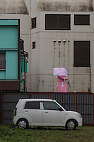 A large pink phallus carried on a mikoshi seen in a quite back street during the Kanamara festival for the steel phallus in Kawasaki Daishi, Kanagawa, Japan. Sunday April 5th 2015 The Kanamara penis festival celebrates a legend about the defeat of a penis-eating demon. It is a wildly popular festival attracting large numbers of locals and foreigners.