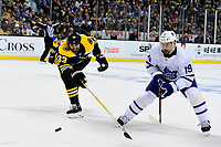 April 25, 2018: Boston Bruins defenseman Nick Holden (44) tries to check the drive of Toronto Maple Leafs center Tomas Plekanec (19) during game seven of the first round of the National Hockey League's Eastern Conference Stanley Cup playoffs between the Toronto Maple Leafs and the Boston Bruins held at TD Garden, in Boston, Mass. Boston defeats Toronto 7-4 and wins the best of seven series 4 games to 3 to advance to round two.