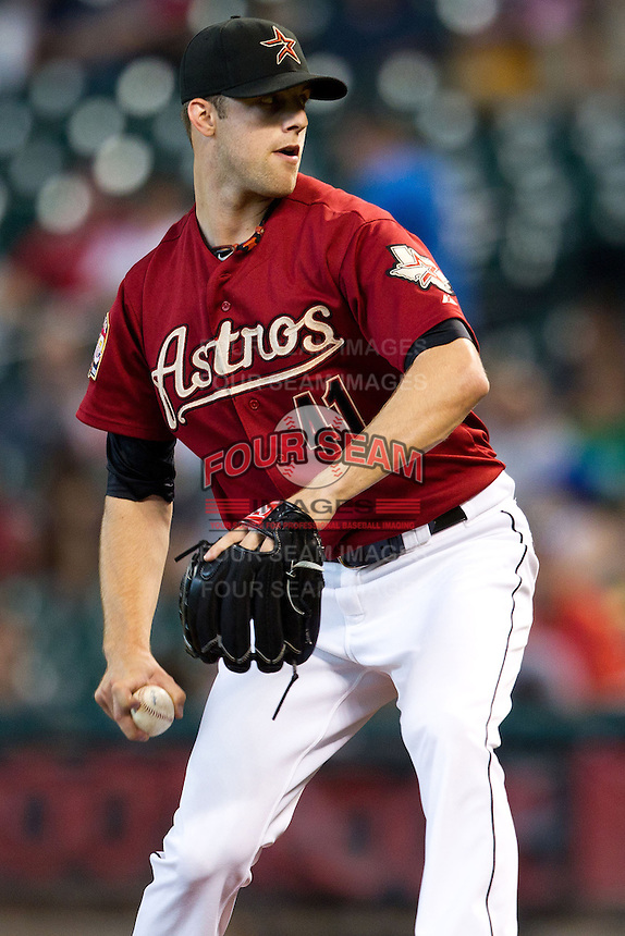 Houston Astros pitcher Jordan Lyles #41 delivers a pitch during the Major League baseball game against the Philadelphia Phillies on September 16th, 2012 at Minute Maid Park in Houston, Texas. The Astros defeated the Phillies 7-6. (Andrew Woolley/Four Seam Images).