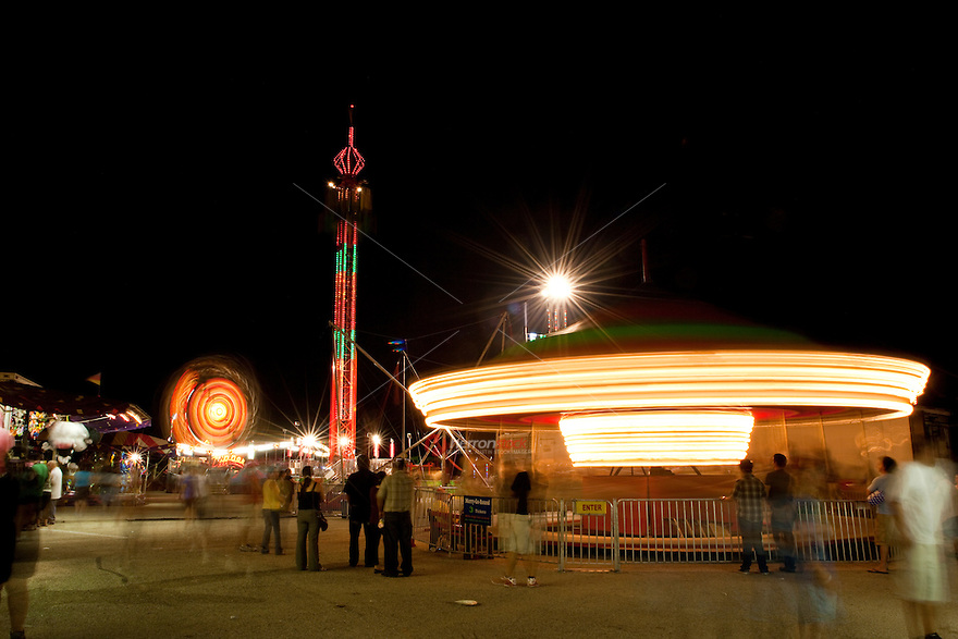 Nighttime scene of carnival Merry-Go-Round rides in austin, texas