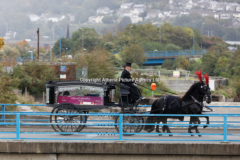 "Pictured: The horse drawn carriage drives towards Margam Crematorium, Wales, UK. Monday 08 October 218<br /> Re: A grieving father will mourners on horseback at the funeral of his ""wonderful"" son who killed himself after being bullied at school.<br /> Talented young horse rider Bradley John, 14, was found hanged in the school toilets by his younger sister Danielle.<br /> Their father, farmer Byron John, 53, asked the local riding community to wear their smart hunting gear at Bradley's funeral.<br /> Police are investigating Bradley's death at the 500-pupils St John Lloyd Roman Catholic school in Llanelli, South Wales.<br /> Bradley's family claim he had been bullied for two years after being diagnosed with Attention Deficit Hyperactivity Disorder.<br /> He went missing during lessons and was found in the toilet cubicle by his sister Danielle, 12."