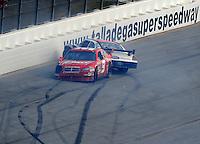 Oct 5, 2008; Talladega, AL, USA; NASCAR Sprint Cup Series drivers Kasey Kahne (9) and David Gilliland (38) after crashing during the Amp Energy 500 at the Talladega Superspeedway. Mandatory Credit: Mark J. Rebilas-