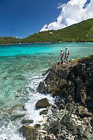 Two hikers on the rocks between Hawksnest Beach and Little Hawksnest Beach<br /> Virgin Islands National Park<br /> St. John, U.S. Virgin Islands