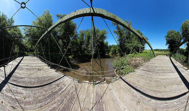 A 180 degree panoramic composite image of the McDowell Bridge over the North Skunk River in the Millgrove Access Wildlife Area in southwest Poweshiek County, as seen on June 30, 2010.  The bridge, built in 1883 by King Iron Bridge Company, was one of 19 bowstring truss bridges remaining in Iowa before it was swept away by flood waters on the river over the weekend of August 14.