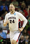 Gonzaga's Pryemek Karnowski yells after dunking a basket against Iowa during the 2015 NCAA Division I Men's Basketball Championship's March 22, 2015 at the Key Arena in Seattle, Washington. #2 Gonzaga beat #7 Iowa 87-68 to advance to the Sweet 16.