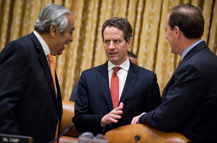 Secretary of the Treasury Tim Geithner, center, talks with Chairman Charlie Rangel, D-N.Y., left, and ranking member Dave Camp, R-Mich., before a hearing of the House Ways and Means Committee on the FY 2011 budget, Feb. 3, 2010.