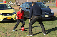 Piscataway, NJ, April 24, 2016.  A father and son play a little parking lot soccer prior to the game between the Washington Spirit and Sky Blue FC.  The Washington Spirit defeated Sky Blue FC 2-1 during a National Women's Soccer League (NWSL) match at Yurcak Field.