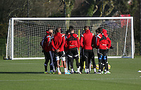 Pictured: Players gather around manager Garry Monk Wednesday 10 December 2014<br />