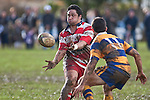 Ray Isara gets the pass away before being tackled by Vernon Comley. Counties Manukau Premier Club Rugby game between Patumahoe & Karaka played at Patumahoe on Saturday June 13th 2009. Patumahoe lead 8 - 0 at halftime and went on to win 20 - 0.