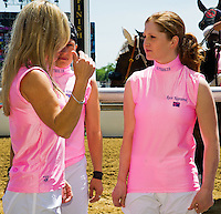 Rosie Napravnik talks with Rosemary Homeister a hug before introductions for the Female Jockey Challenge on Black-Eyed Susan Day at Pimlico Race Course in Baltimore, Maryland on May 18, 2012.