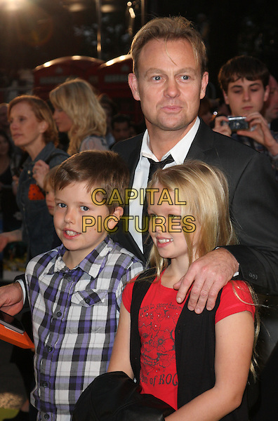 JASON DONOVAN & family .Attending the European Premiere of 'Despicable Me' at the Empire cinema, Leicester Square, London, England, UK, .October 11th 2010.half length  kids children son daughter black white shirt tie jacket suit .CAP/ROS.©Steve Ross/Capital Pictures
