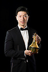 Ma Long of China poses backstage with his Male Table Tennis trophy during the ITTF Star Awards on 8th December 2016, in Doha, Qatar. Photo by Victor Fraile / Power Sport Images