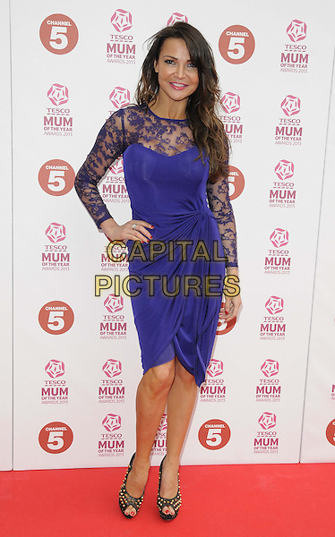 Lizzie Cundy.attended the Tesco Mum Of The Year Awards 2013, Savoy Hotel, The Strand, London, England..March 3rd, 2013.full length blue purple dress lace hand on hip.CAP/CAN.©Can Nguyen/Capital Pictures.