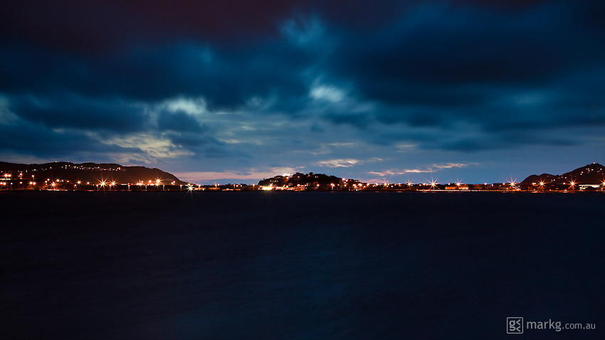 A strong northerly storm brews over Evans Bay in Wellington, New Zealand just after sunset. You can see Miramar & the airport to the left of frame & Rongotai & Kilbirnie to the right.
