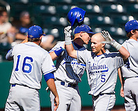 Koby Kraemer (5) of the Indiana State Sycamores is congratulated by teammates after hitting a home run during a game against the Evansville Purple Aces in the 2012 Missouri Valley Conference Championship Tournament at Hammons Field on May 23, 2012 in Springfield, Missouri. (David Welker/Four Seam Images).