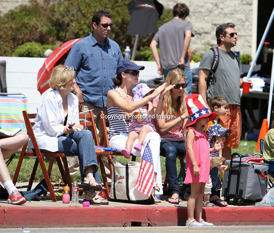 July 4th 2010...Jennifer Garner watching the 4th of July Parade in Pacific Palisades califronia with her kids Violet Seraphina Rose Elizabeth.  Jennifer was wearing a West Virginia baseball hat cap, blue & white stripped shirt & white pants. The kids ate cotton candy & wore American flag hats & waved flags around as they watched the parade. Jennifer ate wheat thins, clapped, cheered & waved at the floats. Jennifer even showed off some cleavage to the passing parade. ...AbilityFilms@yahoo.com.805-427-3519.www.AbilityFilms.com..