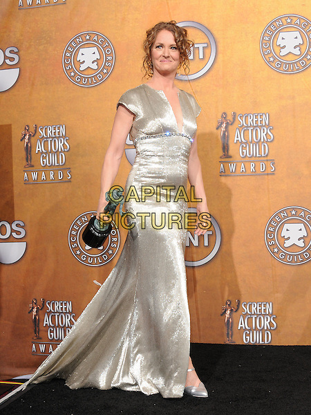 MELISSA LEO.The 17th Annual Screen Actors Guild Awards held at The Shrine Auditorium in Los Angeles, California, USA..January 30th, 2011.pressroom press room full length silver gold sparkly dress slit split dress winner trophy award  .CAP/RKE/DVS.©DVS/RockinExposures/Capital Pictures.
