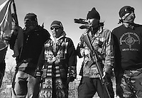 An American Indian Movement members at the Wounded Knee memorial during the 40th anniversary of the occupation of Wounded Knee. In the Reservation the men who participated in the Wounded Knee stand off for independence are also considered as veterans and honored in the annual veteran Pow wow.