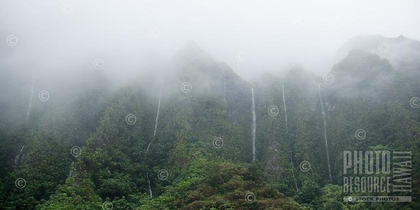 Multiple waterfalls spill down the Ko'olau Mountain Range; shot from the H-3 Freeway on O'ahu.