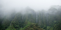 Multiple waterfalls spill down the Ko'olau Mountain Range; shot from the H-3 Freeway on O'ahu.