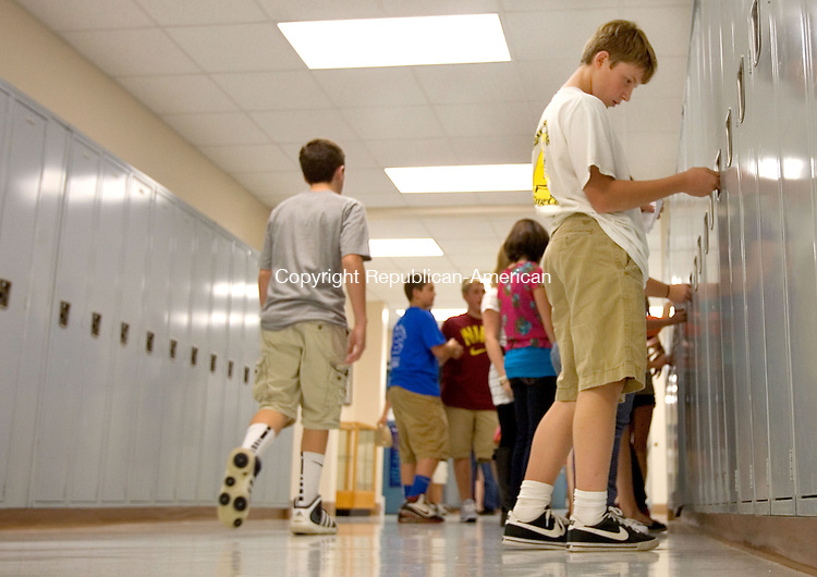 WOODBURY, CT. 06 September 2011-090611SV01--At right, Weston Ratcliffe, 13, tries his new locker combination during his first day of 8th grade at Woodbury Middle School in Woodbury Tuesday.<br /> Steven Valenti Republican-American