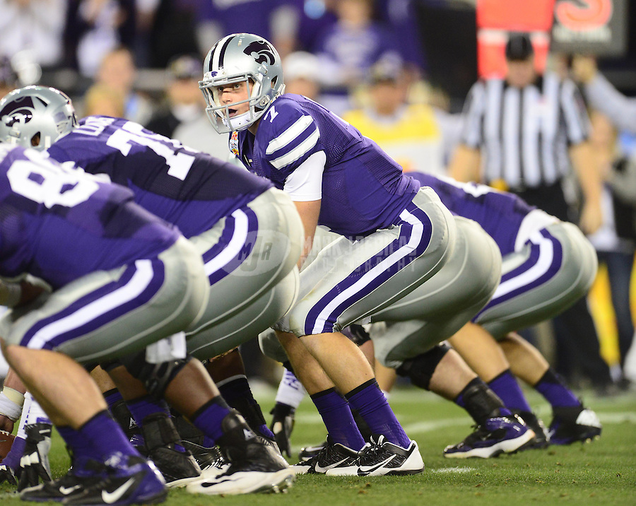Jan. 3, 2013; Glendale, AZ, USA: Kansas State Wildcats quarterback Collin Klein (7) prepares to take the snap in the first quarter against the Oregon Ducks during the 2013 Fiesta Bowl at University of Phoenix Stadium. Mandatory Credit: Mark J. Rebilas-