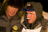 Musher Jeff King speaks with the lead race judge at the finish line of the 2008 All Alaska Sweepstakes on Front Street in Nome.