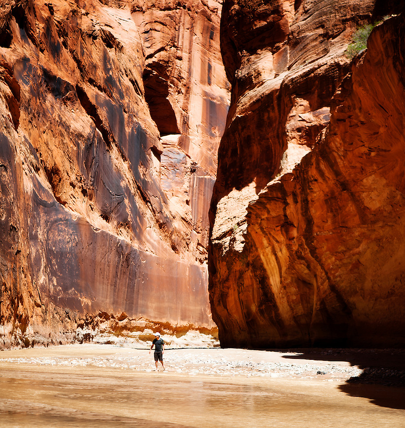 A hiker walks along the Paria River in northern Arizona.