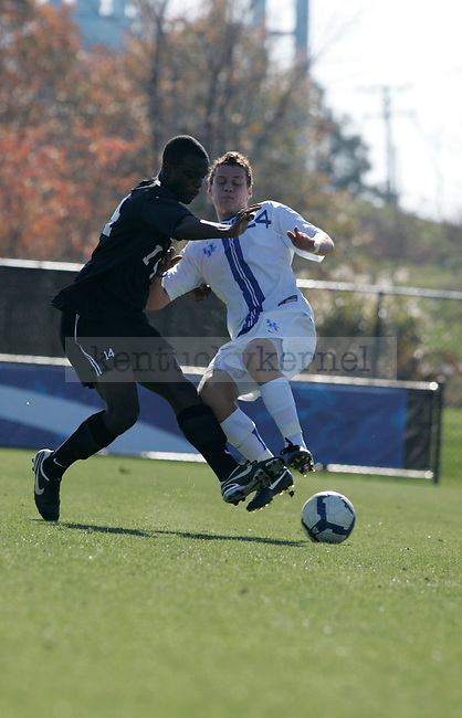 UK's freshman forward Jacob Kemper dribbles the ball during the men's soccer game against High Point University at the Soccer and Softball Complex on Sunday afternoon, Nov. 8, 2009. The Wildcats won 2-0 to the Panthers. Photo by Adam Wolffbrandt | Staff
