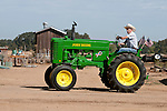 Annual fall Gas-Up at McFarland Ranch near Galt, Calif. of Branch 13, Early-Day Gas Engine and Tractor Association. (EDGE & TA)..Late 1940s John Deere Model M tractor