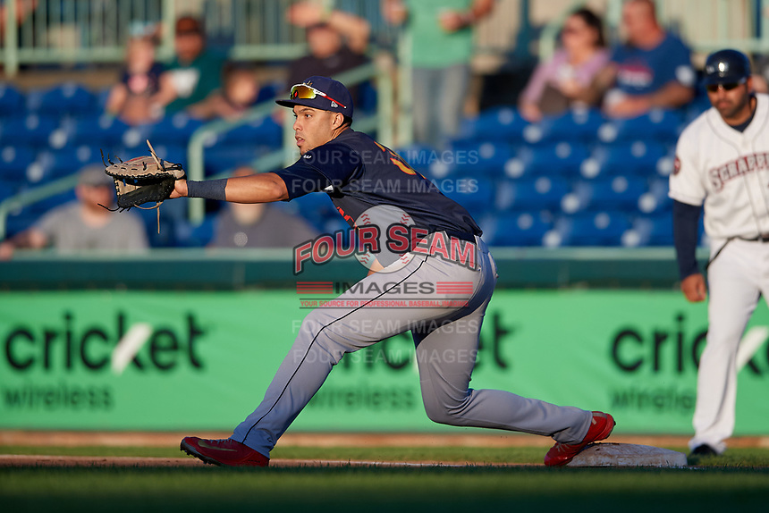 State College Spikes first baseman Dariel Gomez (34) stretches for a throw during a NY-Penn League game against the Mahoning Valley Scrappers on August 29, 2019 at Eastwood Field in Niles, Ohio.  State College defeated Mahoning Valley 8-1.  (Mike Janes/Four Seam Images)