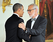Laurie Olin, right, shakes hands with United States President Barack Obama, left, prior to accepting the 2012 National Medal of Arts during the presentation ceremony in the East Room of the White House in Washington, D.C. on Wednesday, July 10, 2013.<br /> Credit: Ron Sachs / CNP