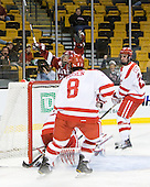 Marshall Everson (Harvard - 21) - The Harvard University Crimson defeated the Boston University Terriers 5-4 in the 2011 Beanpot consolation game on Monday, February 14, 2011, at TD Garden in Boston, Massachusetts.