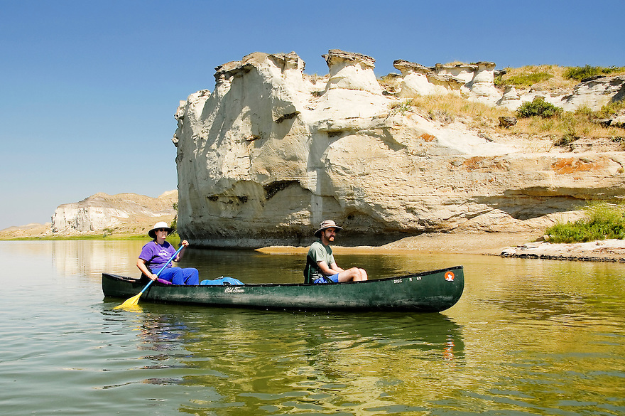 A couple canoe the White Cliffs of the Missouri River in central Montana.