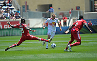 Chicago defender Yamith Cuesta (89) stretches to knock the ball away from New York midfielder Joel Lindpere (20).  The Chicago Fire tied the New York Red Bulls 1-1 at Toyota Park in Bridgeview, IL on June 26, 2011.