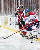 Mike McMurtry (NU - 7), Gregory Amlong (UML - 22) - The Northeastern University Huskies defeated the University of Massachusetts Lowell River Hawks 4-1 (EN) on Saturday, January 11, 2014, at Fenway Park in Boston, Massachusetts.