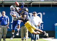 Keenan Allen of California tries to catch a loose ball against Damon Lawrence of Presbyterian during the game at AT&T Park in San Francisco on September 17th, 2011.  California defeated Presbyterian, 63-12.