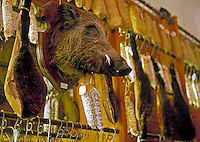 Italy, Tuscany, San Gimignano: decoration in a ham selling shop