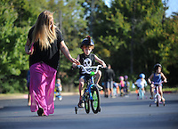 NWA Democrat-Gazette/ANDY SHUPE<br /> Wednesday, Sept. 23, 2015, during the first day of the annual First School Trike Rally at First United Presbyterian Church in Fayetteville. The event, which serves as a fundraiser for St. Jude's Children's Hospital, features bike riding, temporary tattoos, snow cones, a bike wash and demonstrations from the Fayetteville Police Department. Visit nwadg.com/photos to see more photographs from the morning.