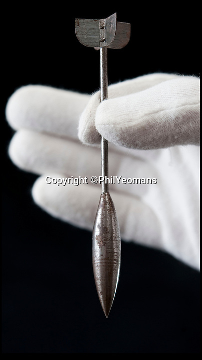 BNPS.co.uk (01202) 558833<br /> Picture: PhilYeomans/BNPS<br /> <br /> From this to Hiroshima in only 31 years...<br /> <br /> A tiny metal missile dropped on enemy troops during the First World War which is regarded as the Britain's first bomb has emerged for sale.<br /> <br /> The five-inch darts were dropped in batches of 500 from attack planes flying over German trenches to devastating effect.<br /> <br /> They were capable of inflicting horrendous wounds - but upstanding British pilots viewed their use as underhand and eventually refused to use them.<br /> <br /> The rudimentary devices, called flechettes, were superseded by darts with exploding tips and then full-scale bombs.<br /> <br /> The flechette for sale is among the personal belongings of Harry Harse, an engineer stationed in France with RFC Squadron 12 in 1916.<br /> <br /> It is expected to fetch &pound;100 when it goes under the hammer at Onslows auction house in Blandford, Dorset, on behalf of relatives of Mr Harse from Reigate, Surrey, on July 9.