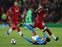 27th November 2019; Anfield, Liverpool, Merseyside, England; UEFA Champions League Football, Liverpool versus SSC Napoli ; Sadio Mane of Liverpool  tangles with Giovanni Di Lorenzo of SSC Napoli as they compete for the ball  - Editorial Use
