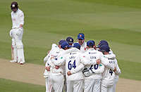 Essex players huddle having taken the wicket of Ollie Pope during Surrey CCC vs Essex CCC, Specsavers County Championship Division 1 Cricket at the Kia Oval on 14th April 2019